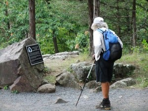 Thru hiker Nimblewill Nomad contemplates the Western Terminus of the Ice Age Trail at the end of his hike.